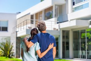 couple with dream home thanks to real estate law attorney